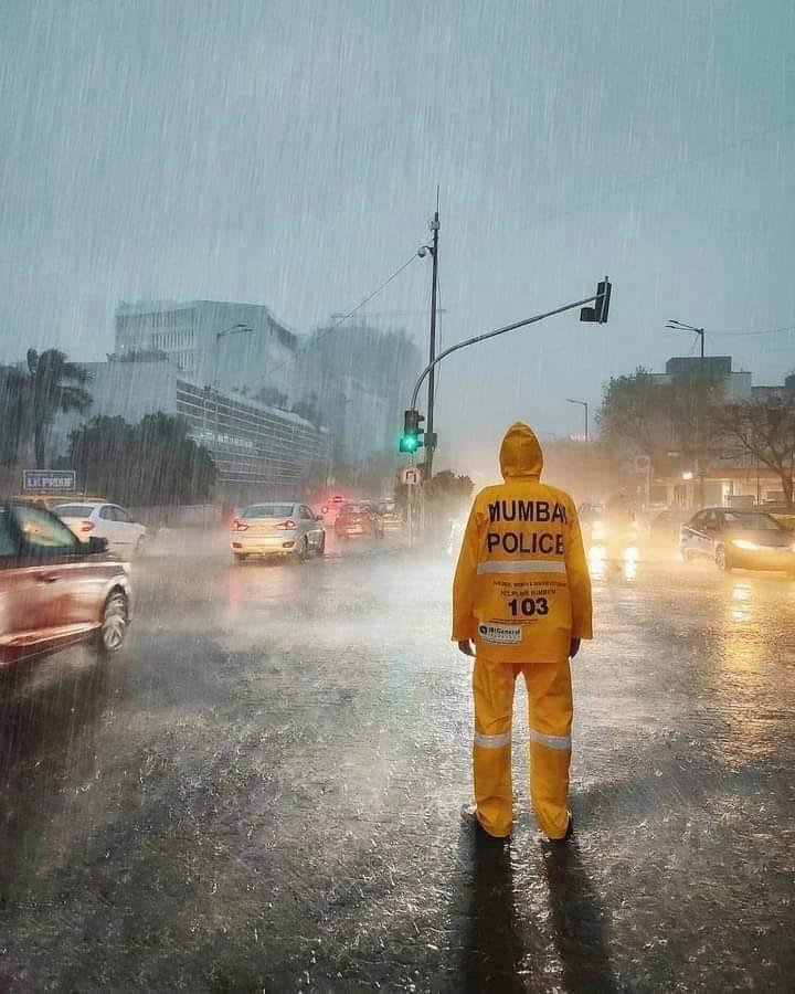 Mumbai Police in Mumbai Rain